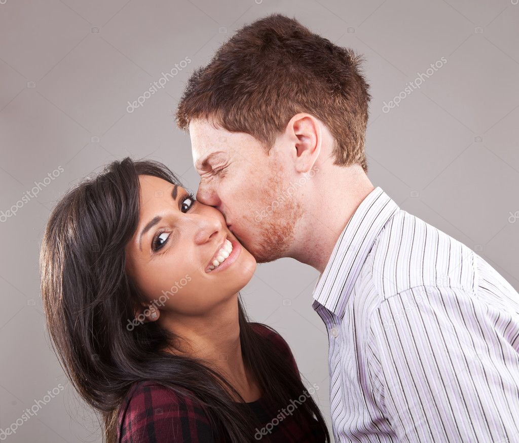 a lady kissing a man