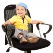 Boy sitting on a business chair — Stock Photo