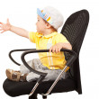 Little boy sitting on a chair — Stock Photo #6026104
