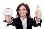 Businesswoman holding blank business card giving thumbs up — Stock Photo