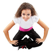 Stylish female dancer sitting — Stock Photo