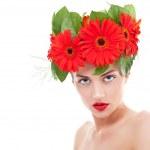 Woman wearing gerbera flowers — Stock Photo #6722920