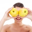 Woman holding apples over her eyes — Stock Photo #6723005
