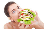Young woman eating fast food — Stock Photo