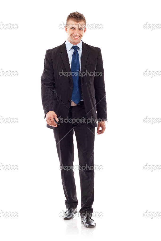 Full body portrait of walking business man, isolated on white background   Stock Photo #6723250