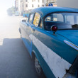 Foto Stock: Old style blue car