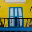 Blue and yellow entrance in cuba - Stock Photo