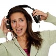 Woman listening loud music - Stock Photo