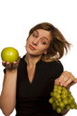 Young woman holding green fruit over white background — Stock Photo