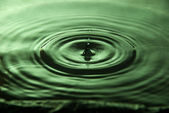 Water droplet on green — Stock Photo