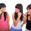 Royalty-Free Stock Photo: Happy Young Women Brushing their Teeth