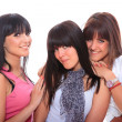Three attractive girls gossiping - Stockfoto