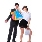 Shopping couple smiling. Isolated over white background — Stock Photo