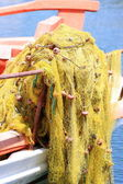 Pile yellow fishing net — Stockfoto