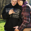 Portrait of young couple with mobile phone — Stock Photo