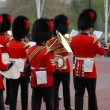 Stock Photo: Queens guards marching and playing music