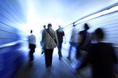 Crowd walking in a corridor — Stock Photo