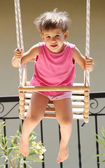 Child swinging — Stock Photo