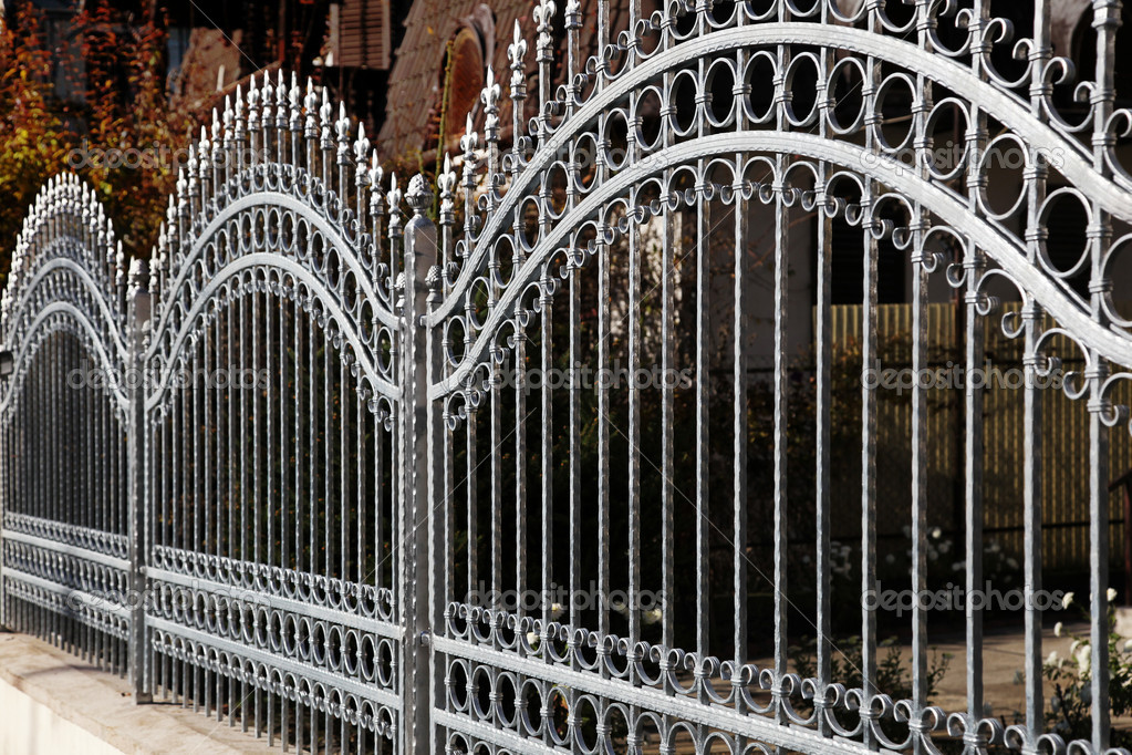 Forged grey decorative iron fence — Stock Photo #6296458