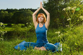 Red woman practicing fitness yoga outdoors — Stock Photo