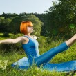 Red woman practicing yoga — Stock Photo #6470577