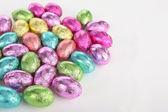 Colorefd easter eggs over white — Stock Photo