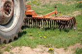 Old farm tractor plow — Stock Photo