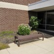 Empty bench by a school building — Stock Photo