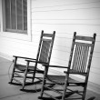 Rocking chairs in black and white — Stock Photo