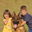 Boy and girl with German shepherd — Stock Photo