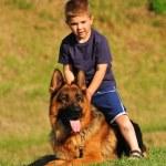 Boy with a German Shepherd — Stock Photo #5865039