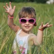 Little girl in meadow — Stock Photo
