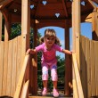 A beautiful little girl on the playground — Stock Photo