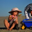 Boy and girl playing on sandy beach — Stock Photo #6609788