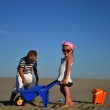 Boy and girl playing on sandy beach — Stock Photo #6609830