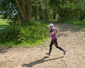 Senior woman running race — Stock Photo