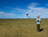Woman standing on Masai Mara — Stock Photo