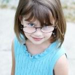 Little girl wearing glasses — Stock Photo