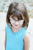 Little girl wearing glasses — Stock Photo