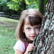 Stock Photo: Child Leaning Against an Oak Tree