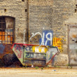 Old damaged container at the backyard of industrial building — Stock Photo #6099009
