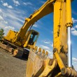 Heavy Duty Construction Equipment Parked at Worksite — Stock Photo #5642374