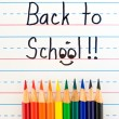 Royalty-Free Stock Photo: Back to School Written on a Lined Dry Erase Board with Colored Pencils