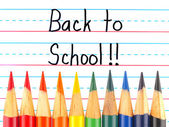 Back to School Written on a Lined Dry Erase Board with Colored Pencils — Zdjęcie stockowe