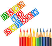 Back to School Written in Alphabet Blocks with Colored Pencils — Stock Photo