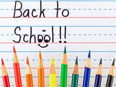 Back to School Written on a Lined Dry Erase Board with Colored Pencils — Stock Photo