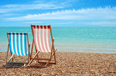 Beach chairs at the ocean — Stockfoto