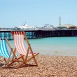 Deck chairs on the beach Brighton England — Stock Photo