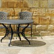 Outdoor patio set with rock wall — Stock Photo #5995833