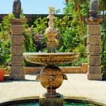 Water fountain arundel castle garden — Stock Photo #6111368